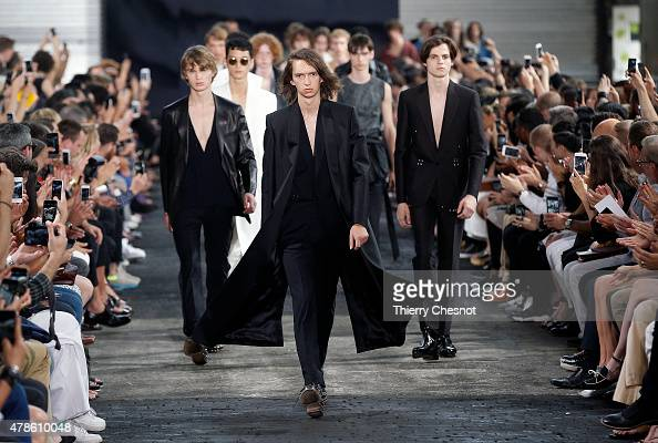 Models walk the runway during the Maison Margiela Menswear Spring/Summer 2016 show as part of Paris Fashion Week on June 26 2015 in Paris France