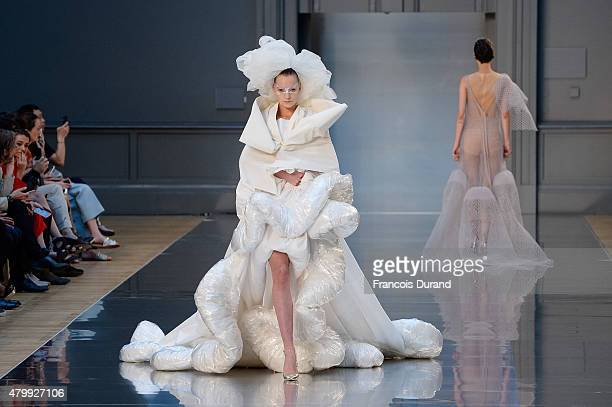 Models walk the runway during the Maison Margiela show as part of Paris Fashion Week Haute Couture Fall/Winter 2015/2016 on July 8 2015 in Paris...