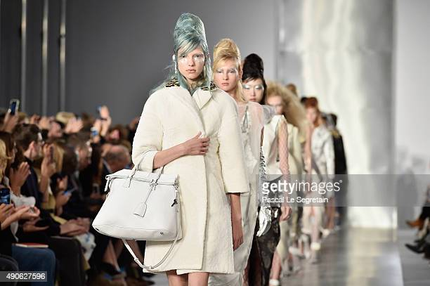 Models walk the runway during the Maison Margiela show as part of the Paris Fashion Week Womenswear Spring/Summer 2016 on September 30 2015 in Paris...