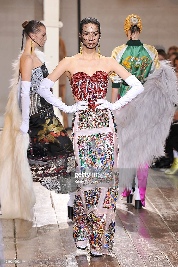 Models walk the runway during the Maison Martin Margiel show as part of Paris Fashion Week Haute Couture Fall/Winter 20142015 on July 9 2014 in Paris...