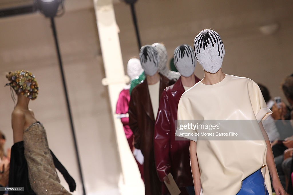 Models walk the runway during the Maison Martin Margiela show as part of Paris Fashion Week Haute-Couture Fall/Winter 2013-2014 at on July 3, 2013 in Paris, France.