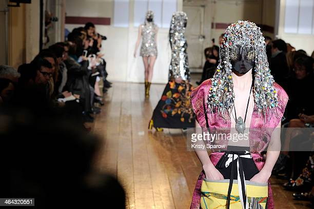 Models walk the runway during the Maison Martin Margiela show as part of Paris Fashion Week Haute Couture Spring/Summer 2014 on January 22 2014 in...
