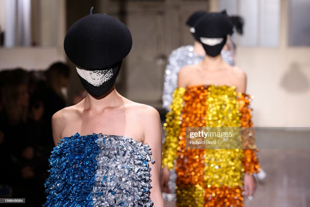 Models walk the runway during the Maison Martin Margiela Spring/Summer 2013 Haute-Couture show as part of Paris Fashion Week at on January 23, 2013 in Paris, France.