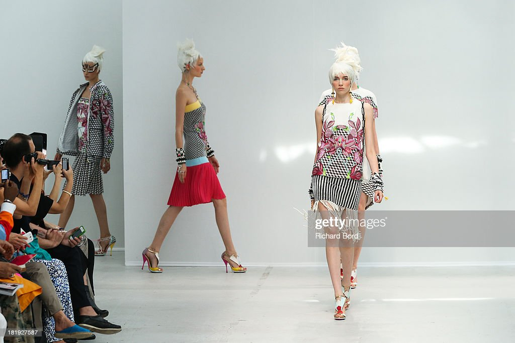 Models walk the runway during the Manish Arora show at Palais de Tokyo as part of the Paris Fashion Week Womenswear Spring/Summer 2014 on September 26, 2013 in Paris, France.