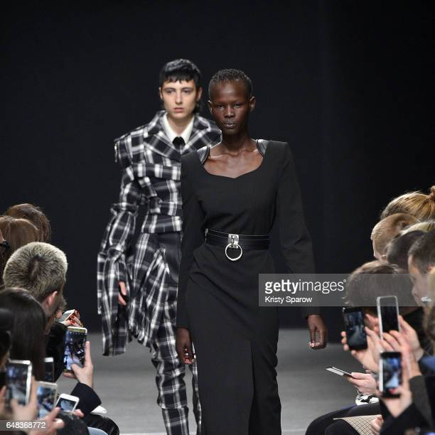 Models walk the runway during the Masha Ma show as part of Paris Fashion Week Womenswear Fall/Winter 2017/2018 on March 5 2017 in Paris France