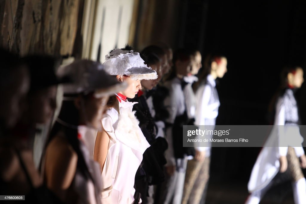 Models walk the runway during the Masha Ma show as part of the Paris Fashion Week Womenswear Fall/Winter 2014-2015 on March 5, 2014 in Paris, France.
