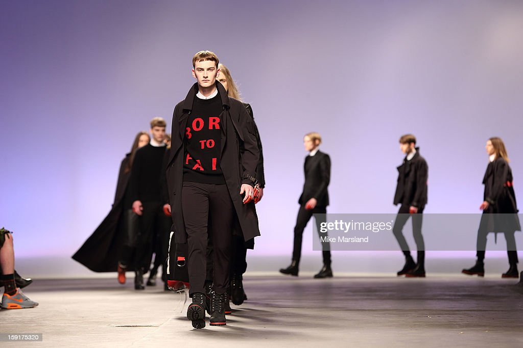 Models walk the runway during the Matthew Miller show at the London Collections: MEN AW13 at The Old Sorting Office on January 9, 2013 in London, England.
