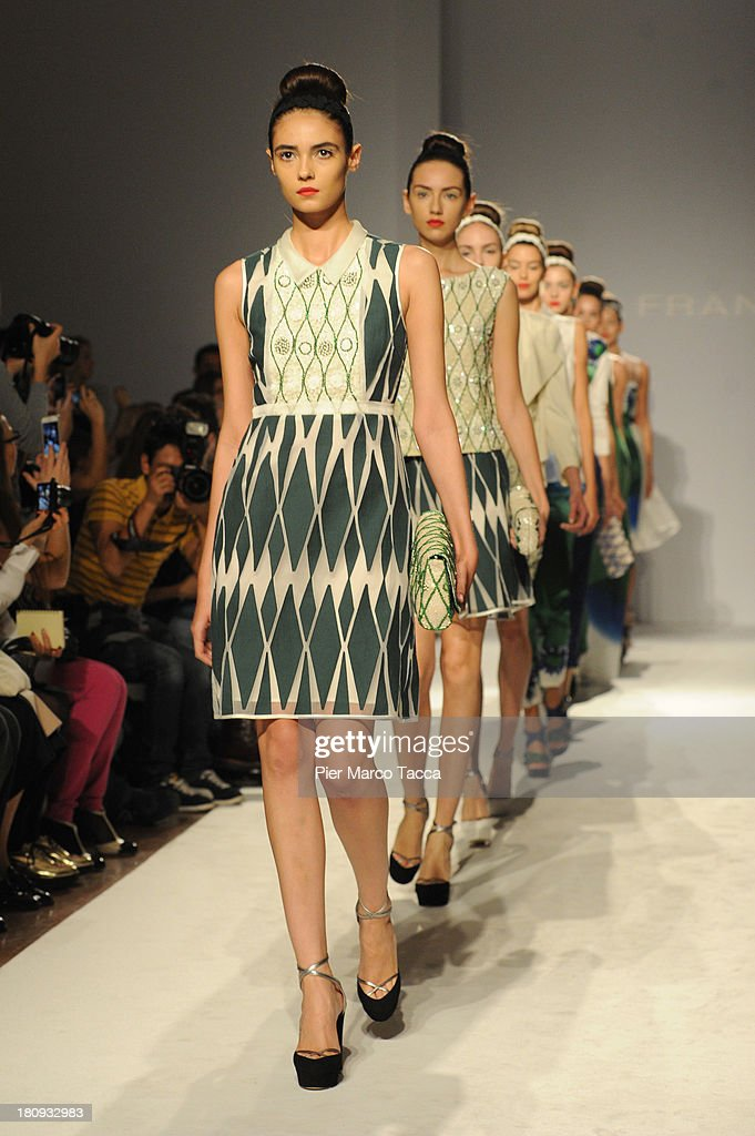 Models walk the runway during the Paola Frani show as a part of Milan Fashion Week Womenswear Spring/Summer 2014 on September 18, 2013 in Milan, Italy.
