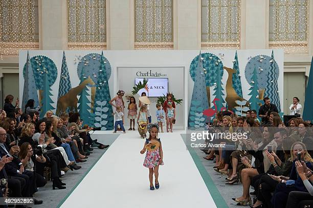 Models walk the runway during The Petite Fashion Week 2nd Edition at the Palacio de Cristal on October 16 2015 in Madrid Spain