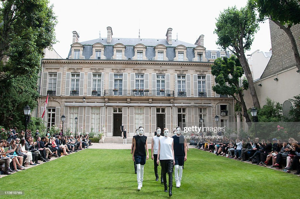 Models walk the runway during the Rad Hourani show as part of Paris Fashion Week Haute-Couture Fall/Winter 2013-2014 at on July 4, 2013 in Paris, France.