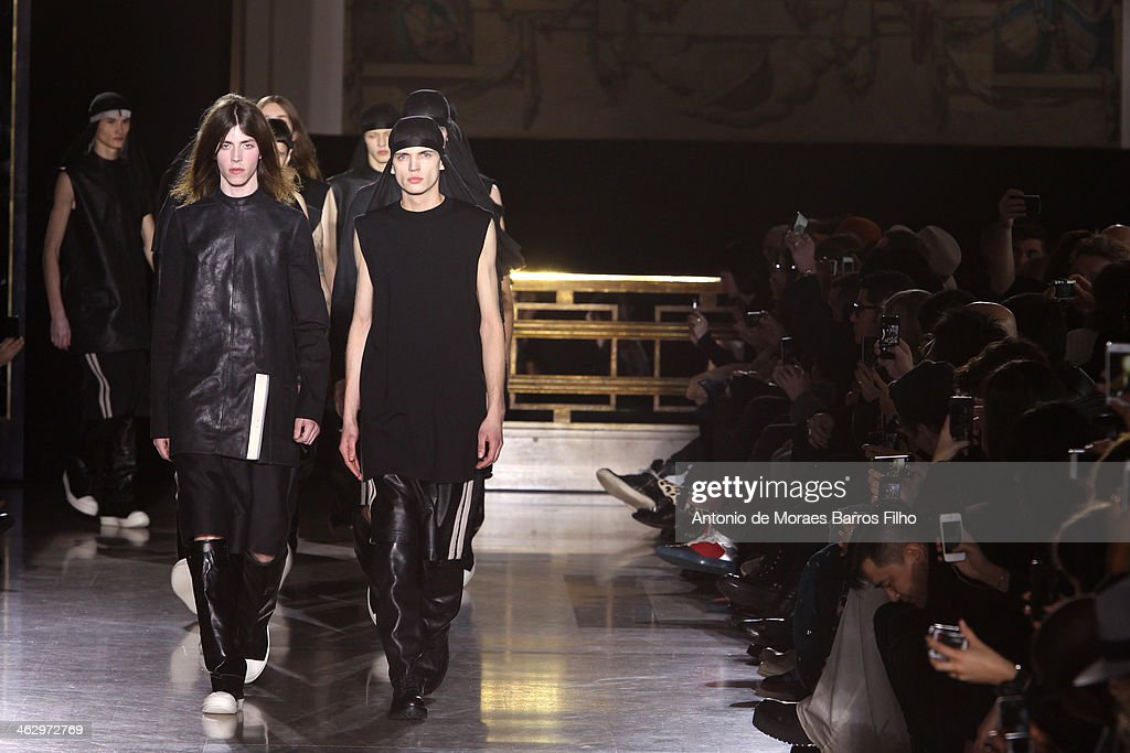 Models walk the runway during the Rick Owens Menswear Fall/Winter 2014-2015 show as part of Paris Fashion Week on January 16, 2014 in Paris, France.