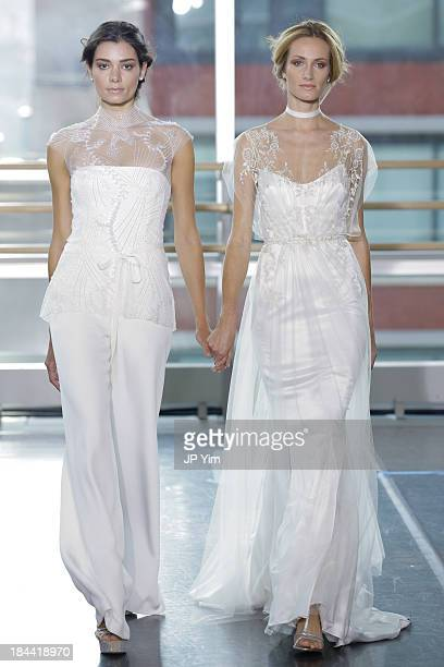Models walk the runway during the Rita VinierisRivini Fall 2014 Bridal Collection at Alvin Alley Studios on October 13 2013 in New York City