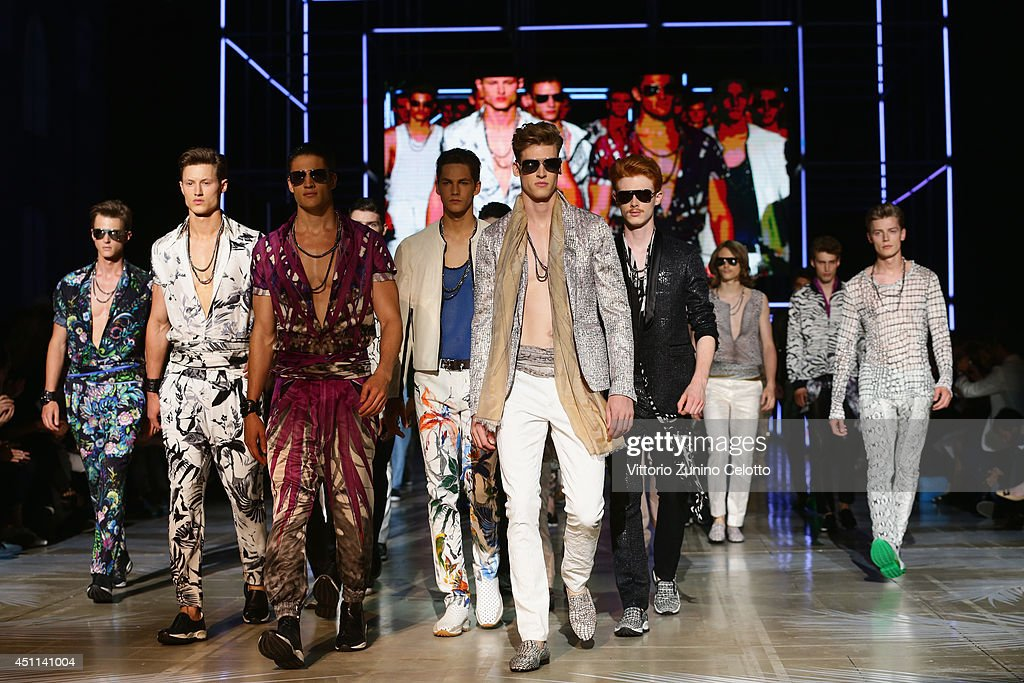 Models walk the runway during the Roberto Cavalli show as part of Milan Fashion Week Menswear Spring/Summer 2015 on June 24, 2014 in Milan, Italy.