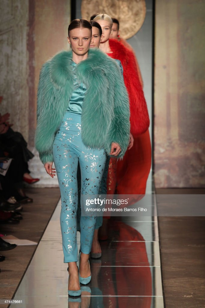 Models walk the runway during the Roccobarocco show as a part of Milan Fashion Week Womenswear Autumn/Winter 2014 on February 23, 2014 in Milan, Italy.