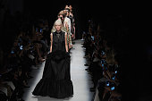 Models walk the runway during the Rochas show as part of the Paris Fashion Week Womenswear Spring/Summer 2016 on September 30 2015 in Paris France
