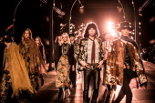 Models walk the runway during the Saint Laurent show as part of the Paris Fashion Week Menswear Spring/Summer 2015 on June 29 2014 in Paris France