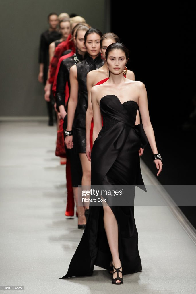 Models walk the runway during the Shiatzy Chen Fall/Winter 2013 Ready-to-Wear show as part of Paris Fashion Week at the Grand Palais on March 5, 2013 in Paris, France.