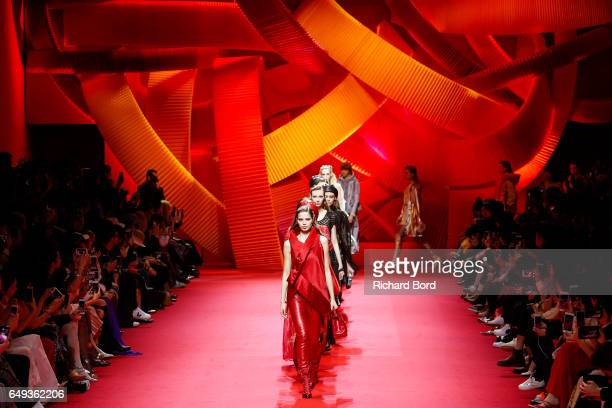 Models walk the runway during the Shiatzy Chen show during Paris Fashion Week Womenswear Fall/Winter 2017/2018 on March 7 2017 in Paris France