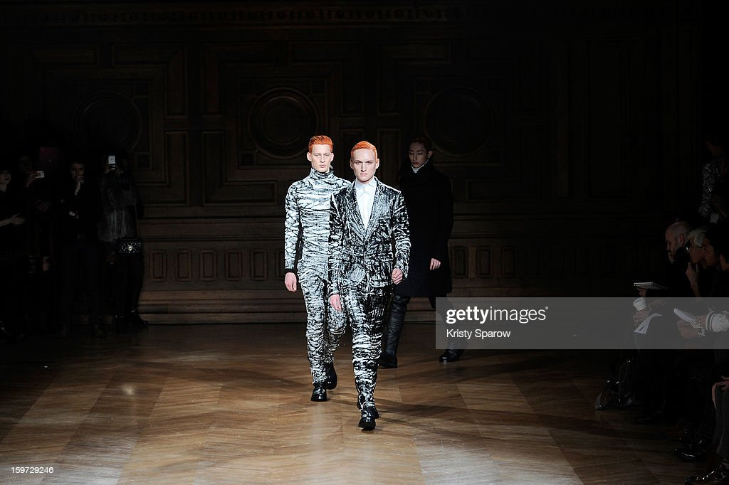 Models walk the runway during the Songzio Menswear Autumn / Winter 2013/14 show as part of Paris Fashion Week on January 19, 2013 in Paris, France.