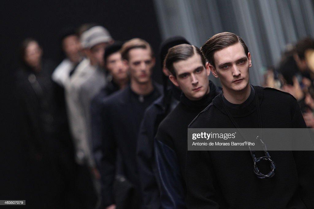 Models walk the runway during the Tillmann Lauterbach Menswear Fall/Winter 2014-2015 show as part of Paris Fashion Week on January 18, 2014 in Paris, France.