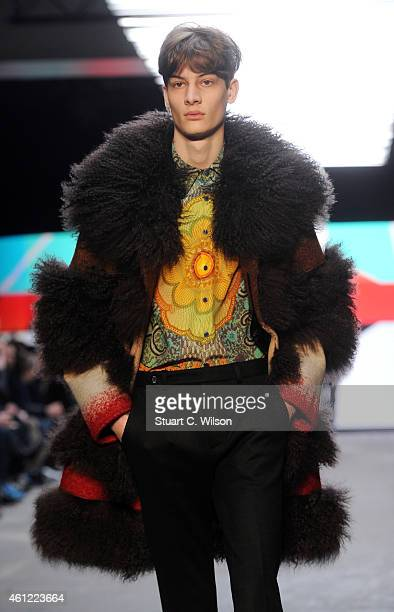 Models walk the runway during the TOPMAN Design show at the London Collections Men AW15 at The Old Sorting Office on January 9 2015 in London England
