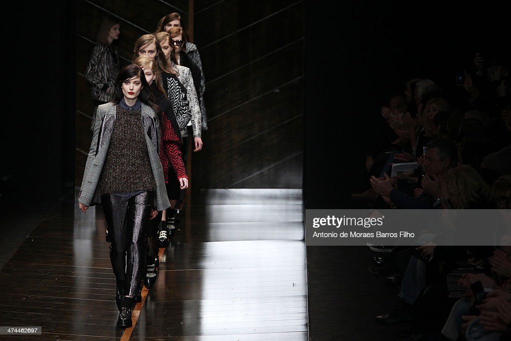 Models walk the runway during the Trussard show as a part of Milan Fashion Week Womenswear Autumn/Winter 2014 on February 23, 2014 in Milan, Italy.
