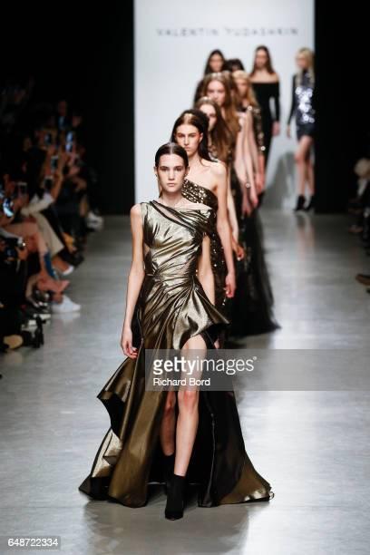 Models walk the runway during the Valentin Yudashkin show at Palais de Tokyo during Paris Fashion Week Womenswear Fall/Winter 2017/2018 on March 6...