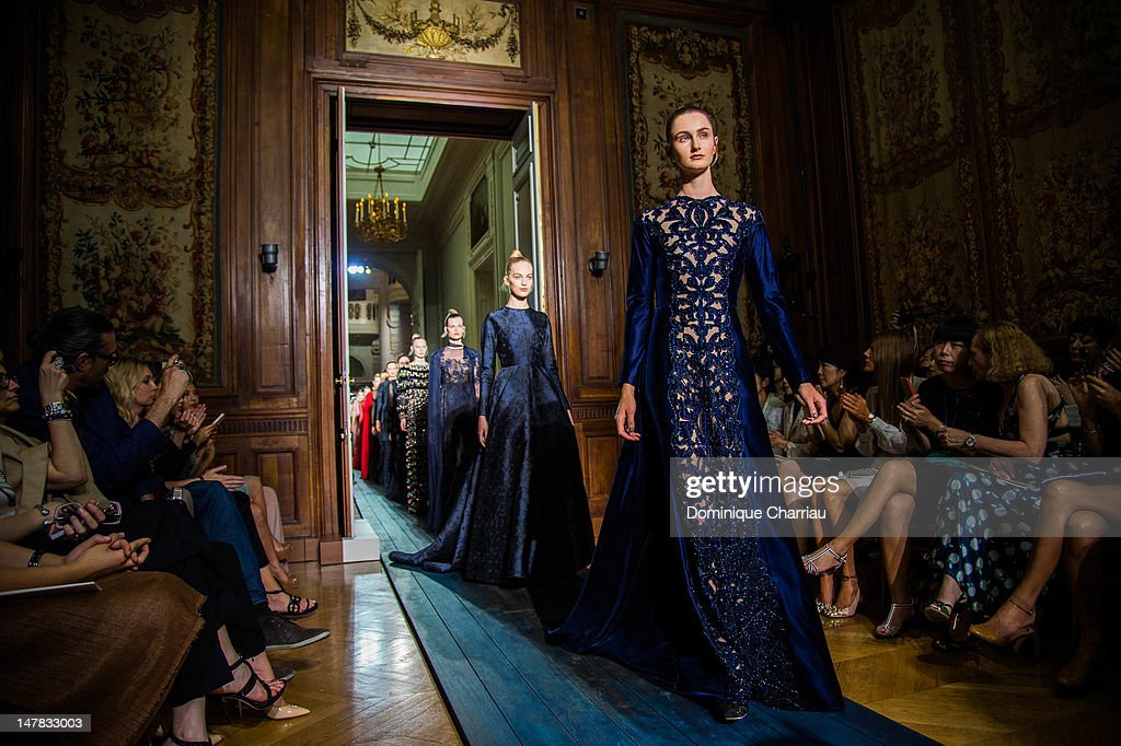 Models walk the runway during the Valentino Haute-Couture Show as part of Paris Fashion Week Fall / Winter 2012/2013 at Hotel Salomon de Rothschild on July 4, 2012 in Paris, France.