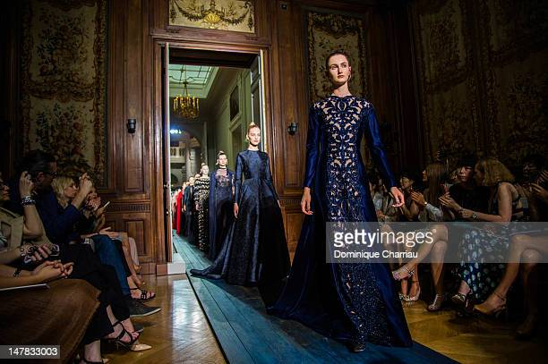 Models walk the runway during the Valentino HauteCouture Show as part of Paris Fashion Week Fall / Winter 2012/2013 at Hotel Salomon de Rothschild on...
