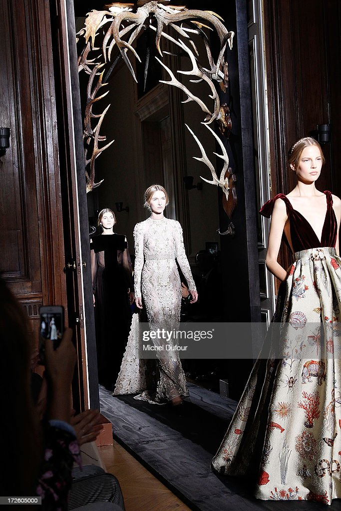 Models walk the runway during the Valentino show as part of Paris Fashion Week Haute-Couture Fall/Winter 2013-2014 at Hotel Salomon de Rothschild on July 3, 2013 in Paris, France.