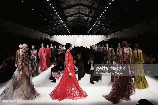 Models walk the runway during the Valentino show as part of the Paris Fashion Week Womenswear Fall/Winter 20142015 on March 4 2014 in Paris France