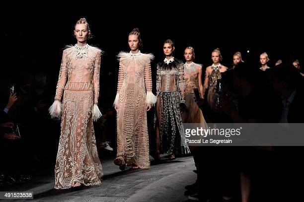 Models walk the runway during the Valentino show as part of the Paris Fashion Week Womenswear Spring/Summer 2016 on October 6 2015 in Paris France