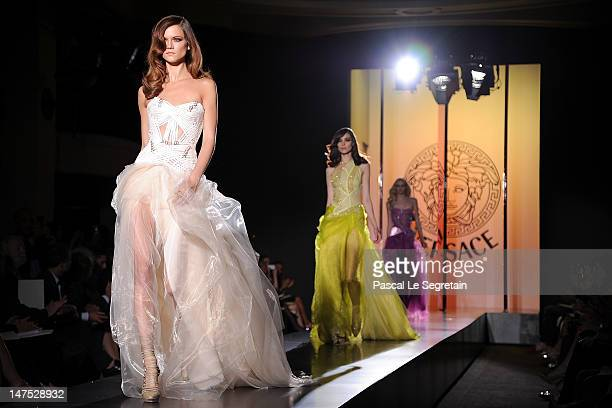 Models walk the runway during the Versace HauteCouture show as part of Paris Fashion Week Fall / Winter 2012/13 at the Ritz hotel on July 1 2012 in...