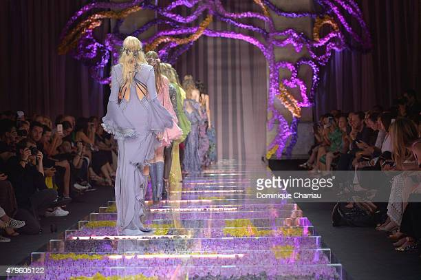 Models walk the runway during the Versace show as part of Paris Fashion Week Haute Couture Fall/Winter 2015/2016 on July 5 2015 in Paris France