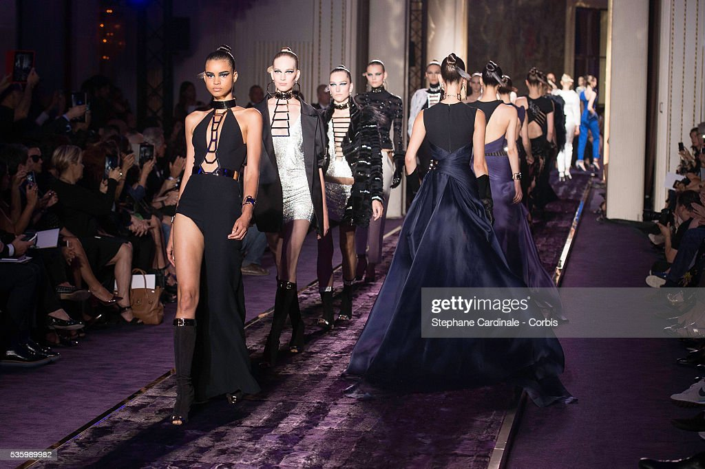 Models walk the runway during the Versace show as part of Paris Fashion Week - Haute Couture Fall/Winter 2014-2015 on July 6, 2014 in Paris, France.