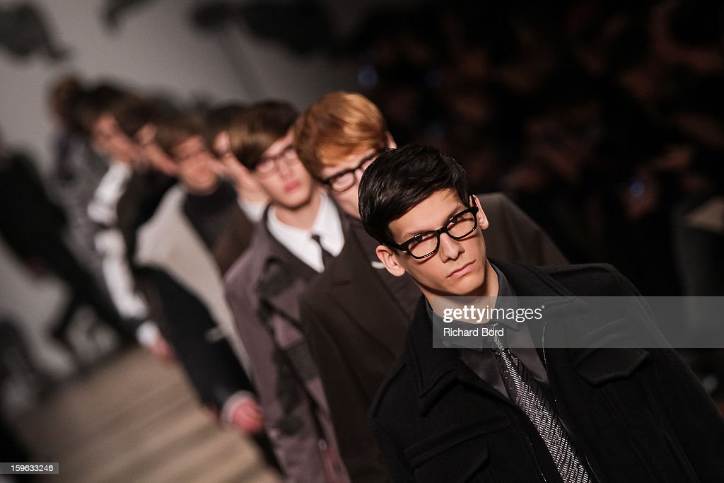 Models walk the runway during the Viktor&Rolf Men Autumn / Winter 2013 show as part of Paris Fashion Week on January 17, 2013 in Paris, France.