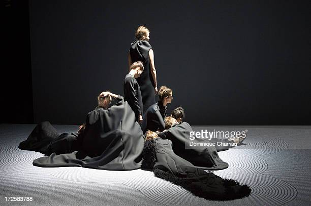 Models walk the runway during the ViktorRolf show as part of Paris Fashion Week HauteCouture Fall/Winter 20132014 at La Gaite Lyrique on July 3 2013...