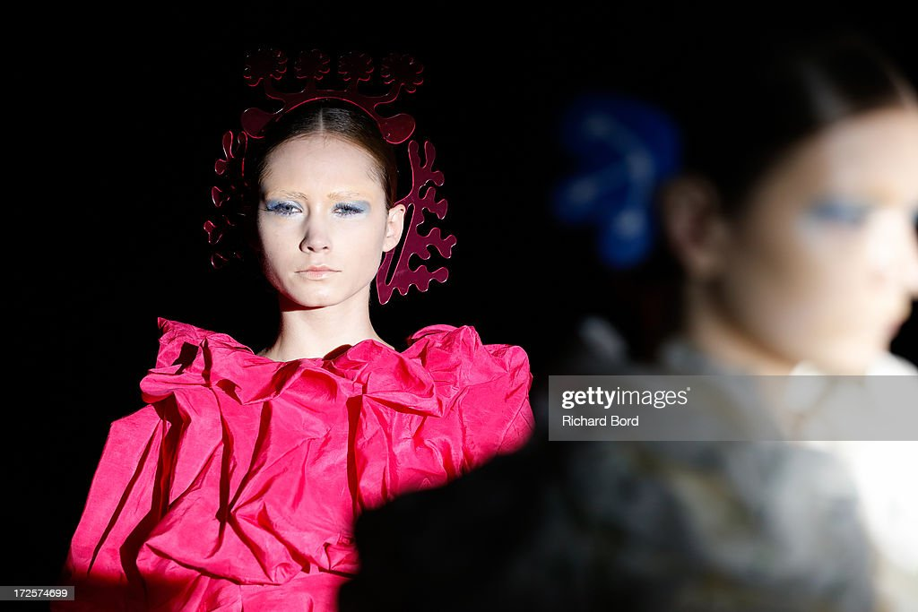 Models walk the runway during the Yoshiki Hishinuma Couture show as part of Paris Fashion Week Haute-Couture Fall/Winter 2013-2014 at Hotel Lutetia on July 3, 2013 in Paris, France.