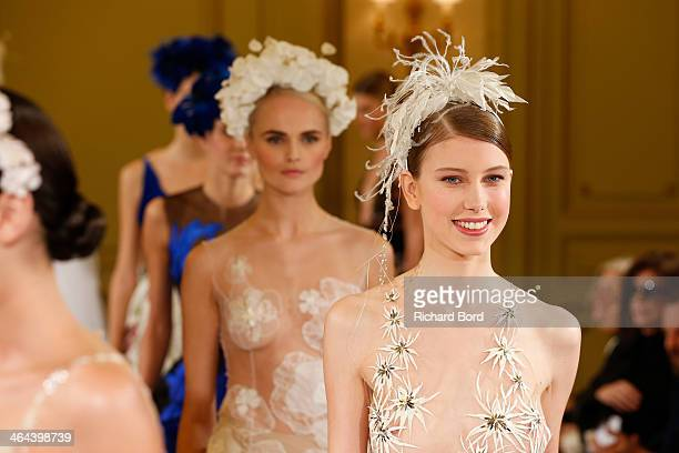 Models walk the runway during the Yulia Yanina show as part of Paris Fashion Week Haute Couture Spring/Summer 2014 at Hotel Meurice on January 22...
