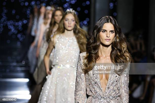 Models walk the runway during the Zuhair Murad show as part of Paris Fashion Week Haute Couture Fall/Winter 2015/2016 on July 9 2015 in Paris France