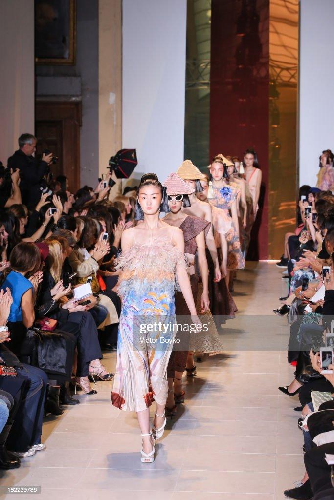 Models walk the runway during Tsumori Chisato show as part of the Paris Fashion Week Womenswear Spring/Summer 2014 on September 28, 2013 in Paris, France.