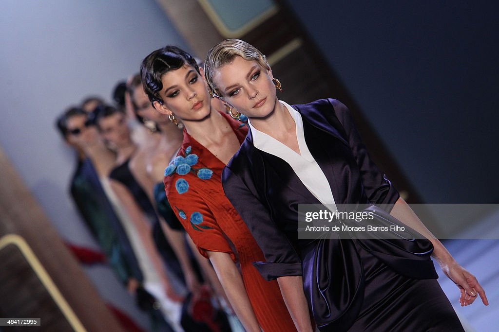 Models walk the runway during Ulyana Sergeenko show as part of Paris Fashion Week Haute Couture Spring/Summer 2014 on January 21, 2014 in Paris, France.