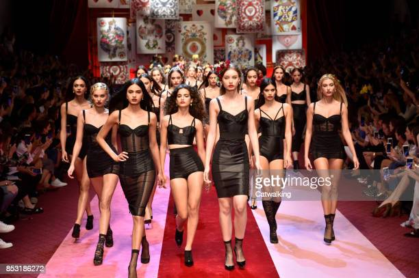 Models walk the runway finale at the Dolce Gabbana Spring Summer 2018 fashion show during Milan Fashion Week on September 24 2017 in Milan Italy