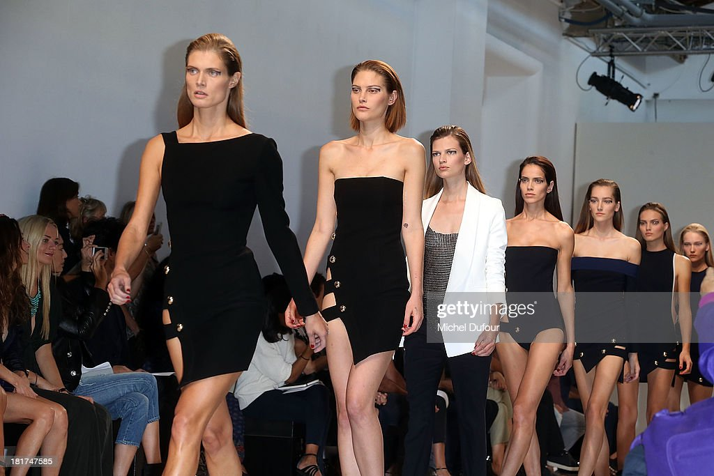 Models walk the runway for final during Anthony Vaccarello show as part of the Paris Fashion Week Womenswear Spring/Summer 2014 on September 24, 2013 in Paris, France.