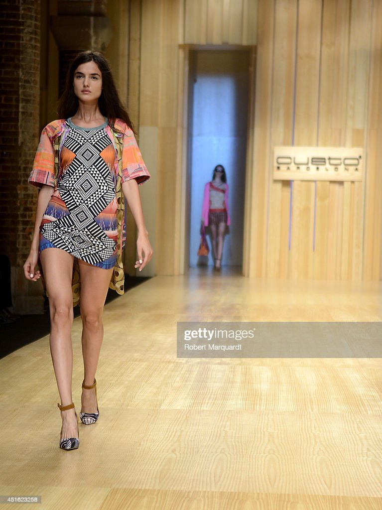 Models walk the runway for the 'Custo Barcelona' summer 2015 collection at the 080 Barcelona Fashion Week on July 2, 2014 in Barcelona, Spain.