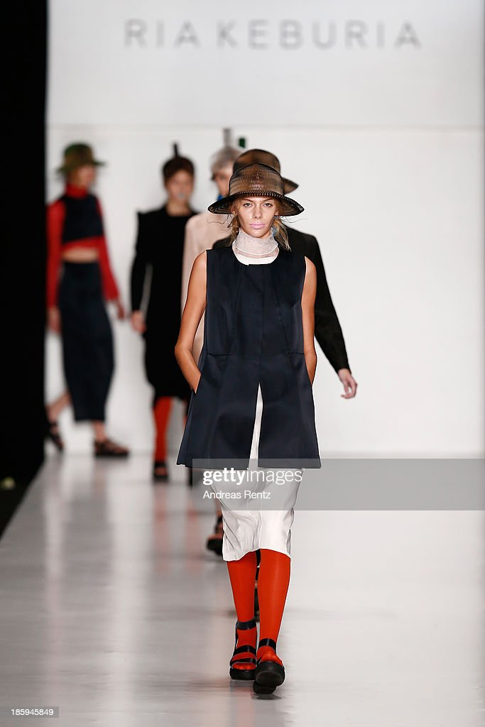 Models walk the runway for the finale of the RIA KEBURIA show during Mercedes-Benz Fashion Week Russia S/S 2014on October 26, 2013 in Moscow, Russia.
