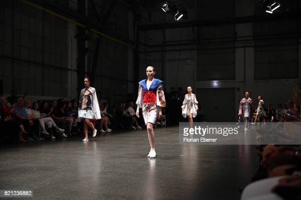 Models walk the runway for the 'Project Upcycling' show during the AMD Exit17_2 show during Platform Fashion July 2017 at Areal Boehler on July 23...