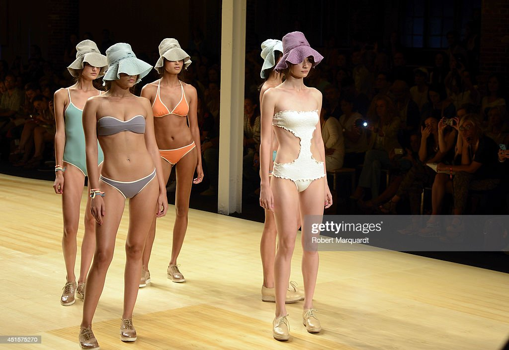 Models walk the runway for the 'TCN 2015 Summer' collection at the 080 Barcelona Fashion Week 2014 on July 1, 2014 in Barcelona, Spain.