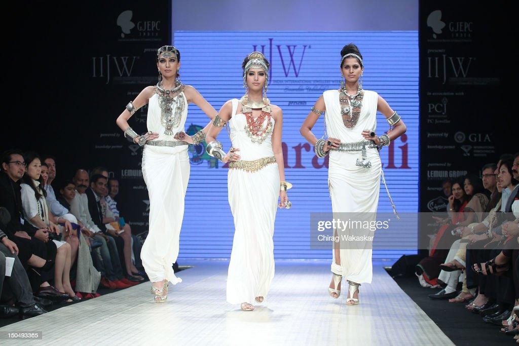 Models walk the runway in a Amrapali Jewellery design at the India International Jewellery Week 2012 Day 1 at the Grand Hyatt on on August 19, 2012 in Mumbai, India.