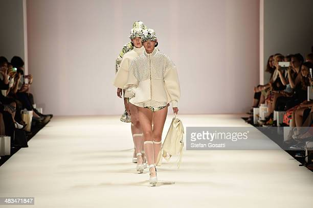 Models walk the runway in a design by Gabriel Lee at the Raffles show during MercedesBenz Fashion Week Australia 2014 at Carriageworks on April 9...